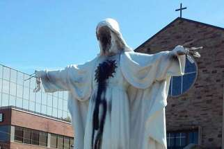 Sacred Heart of Jesus statue outside Mississauga was desecrated in Ont.'s St. Catherine of Siena Church in 2015, investigated by the police as a hate crime.