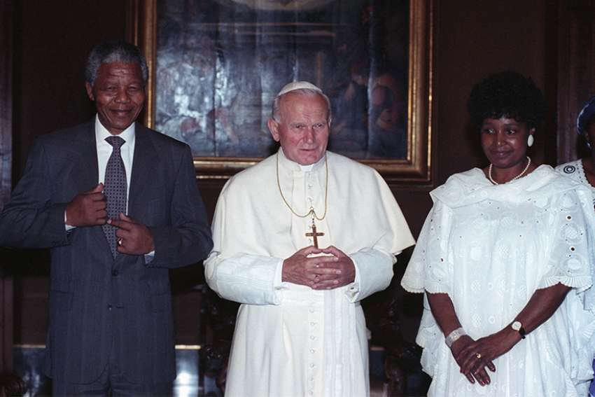 St. John Paul II poses with Nelson Mandela and his wife, Winnie Madikizela-Mandela, in 1990 at the Vatican.