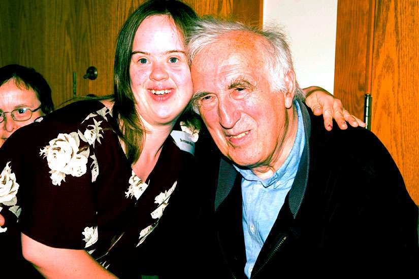 "Jean Vanier, left, with Amanda, a member of the L'Arche community in Canada. Vanier has won the 2015 Templeton Prize for making ""exceptional contributions"" to affirming the spiritual aspect of life. He said he will donate the money to his charities so that they can expand the work for people with developmental disabilities internationally."