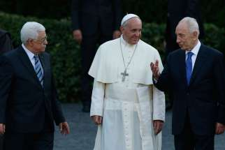Palestinian President Mahmoud Abbas, Pope Francis and the late Israeli President Shimon Peres arrive for an invocation for peace in the Vatican Gardens June 8, 2014.