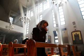 An Assyrian woman prays at a church in Damascus March 1 during a special Mass for Assyrian Christians abducted by Islamic State fighters. Christian leaders again called for help for Assyrian Christians as Islamic State militants stepped up their attacks against their towns in northern Syria.