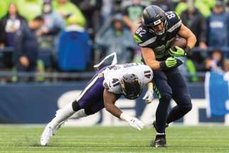Seattle Seahawks' tight end Luke Willson, at right and in action above, will be receiving Assumption University's Christian Culture Gold Medal later this year.