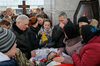 Ukrainians attend a funeral in Kiev Feb. 2 for a serviceman killed in the eastern Ukrainian conflict with Russia.