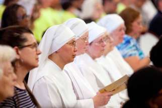 Members of the Little Sisters of the Poor attend the 2014 celebration of the third annual Fortnight for Freedom Mass at the Basilica of the National Shrine of the Assumption of the Blessed Virgin Mary in Baltimore. The 10th U.S. Circuit Court of Appeals ruled July 14 the Little Sisters and other religious entities are not substantially burdened by federal procedures that would enable them to avoid providing contraceptives in health insurance coverage.