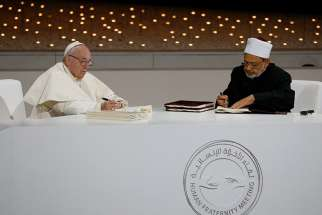 "02.07.2019  Pope Francis and Sheik Ahmad el-Tayeb, grand imam of Egypt's al-Azhar mosque and university, sign documents during an interreligious meeting at the Founder's Memorial in Abu Dhabi, United Arab Emirates, Feb. 4, 2019. The pope and Sheik el-Tayeb stepped into a theological debate on the will of God toward religions when they signed a document on ""human fraternity"" and improving Christian-Muslim relations."
