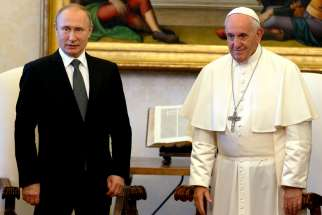 Pope Francis is pictured with Russian President Vladimir Putin during a private audience at the Vatican July 4, 2019.