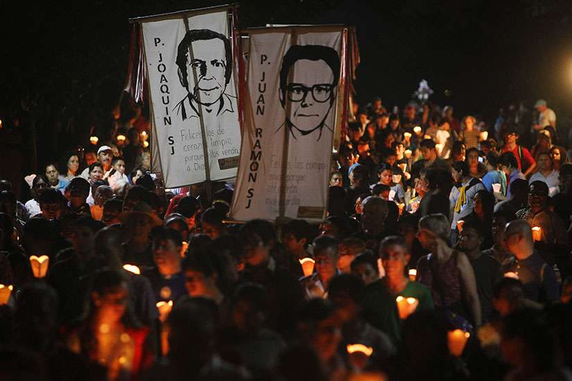 "People participate in the ""little lanterns march"" at the Central American University in San Salvador during the 2015 commemoration of the 26th anniversary of the massacre of six Jesuit priests and two women, murdered in November 1989 by a military commando."