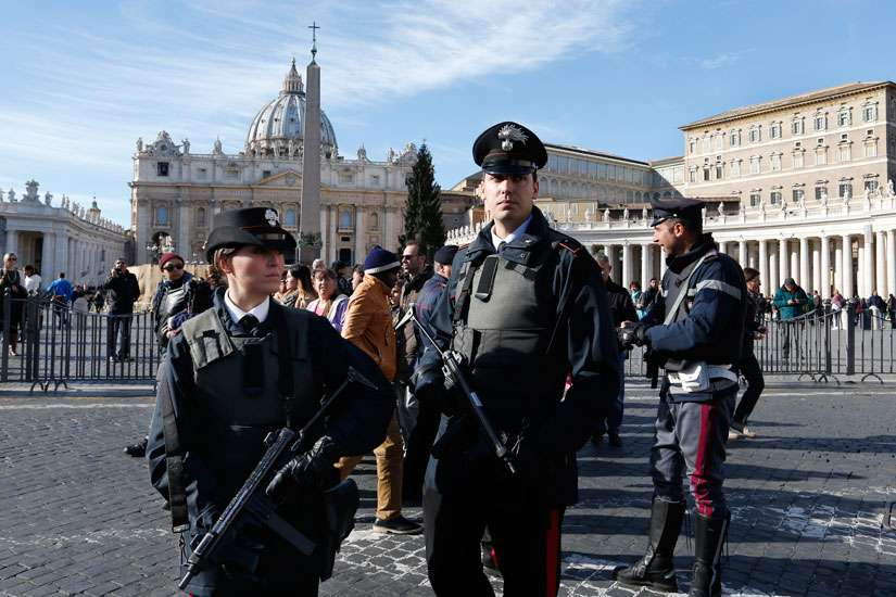 Members of the Carabinieri, the Italian military police force, stand guard as people leave Pope Francis' Angelus blessing in St. Peter's Square at the Vatican Nov. 22.