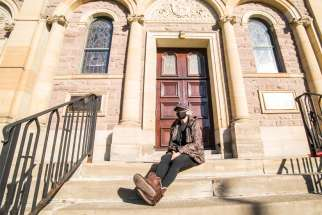 Milanka Pantich, on the steps of St. Paul's Basilica, has learned how invisible you are when you are poor.