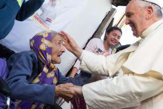 "Pope Francis greets an elderly woman as he meets with people of the Banado Norte neighborhood in Asuncion, Paraguay, in this July 12, 2015, file photo. On Dec. 16, 2019, the eve of his 83rd birthday, Pope Francis met with a group of his peers, although many were a few years younger, and told them that ""old age is a time of grace."""