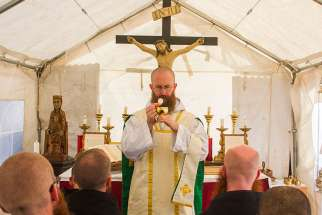 The Rev. Benedict Nivakoff says Mass in September 2016. The American monk is looking to the future after St. Benedict's basilica in Norcia was destroyed by an earthquake Oct. 30.