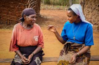 Sister Dativa Mukebita talks with Nikodem Lucian at the Village Angels of Tanzania project in Ngara, Tanzania.