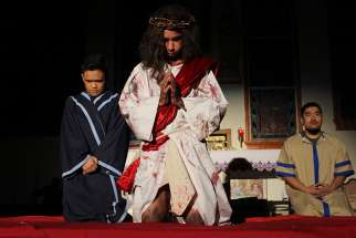 Fourteen-year-old Owen Cacayurin plays Jesus in this year's reenactment of the Stations of the Cross at St. Paschal Baylon Church.