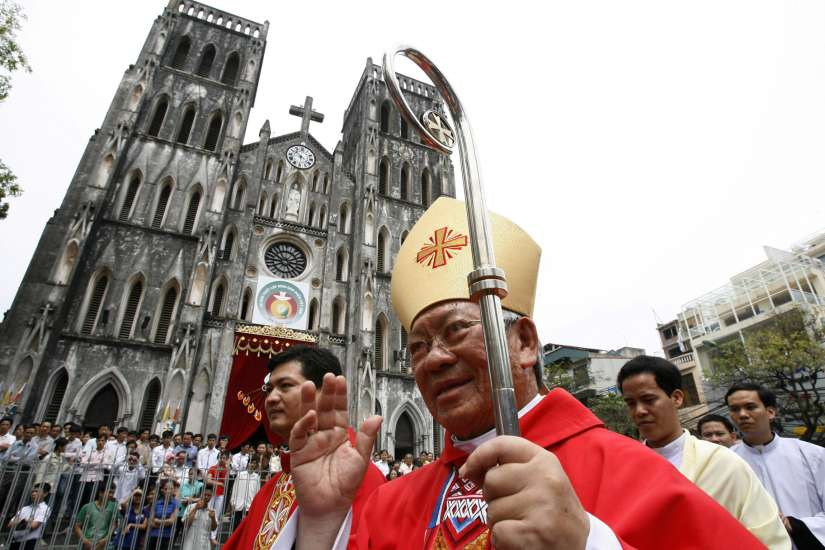 Archbishop Pierre Nguyen Van Nhon of Hanoi, Vietnam, waves in front of St. Joseph Cathedral after Pentecost Mass in this May 23, 2010, file photo. Archbishop Van Nhon, 76, was among the 20 new cardinals named by Pope Francis Jan. 4.