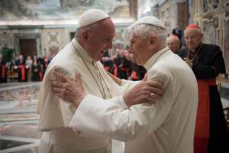 Pope Francis greets retired Pope Benedict XVI during a June 28 ceremony at the Vatican marking the 65th anniversary of the retired pope's priestly ordination.