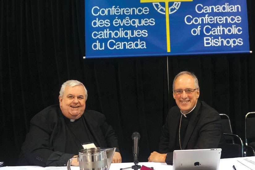 Msgr. Patrick Powers, left, and Archbishop Paul-Andre Durocher at last year's CCCB plenary, held at Sainte-Anne-de-Beaupre.