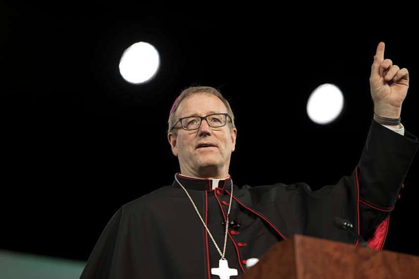 Los Angeles Auxiliary Bishop Robert E. Barron addresses the 2015 World Meeting of Families in Philadelphia Sept. 22.