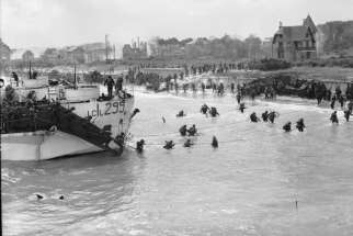 Troops of the 9th Canadian Infantry Brigade going ashore at Bernières-sur-mer, Normandy, France, on D-Day.