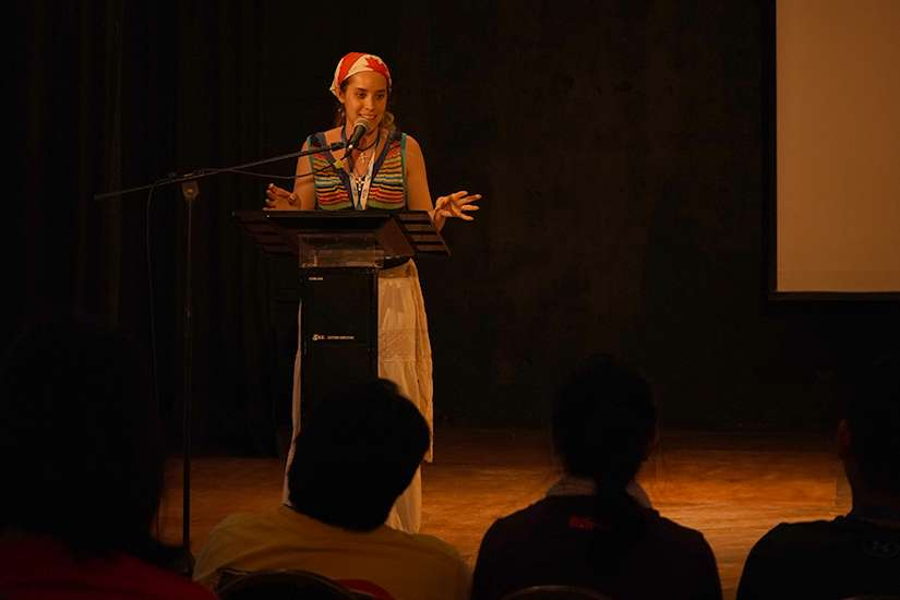 Esther Carmona Wagner speaks to pilgrims during the Catholic Christian Outreach session at Anita Villalaz Theatre in Panama City.