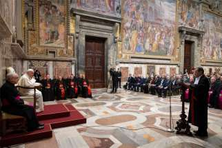 Pope Francis listens as Gian Piero Milano, Vatican chief prosecutor, speaks during an audience at the Vatican.