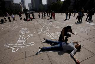 12.28.2017  Demonstrators at the Monument to the Revolution in Mexico City demand justice for victims of violence Dec. 11, 2016. The majority of Catholic Church workers violently killed in 2017 were victims of attempted robberies, the Vatican's Fides agency said, with Nigeria and Mexico topping the list countries where the most brutal murders were carried out.
