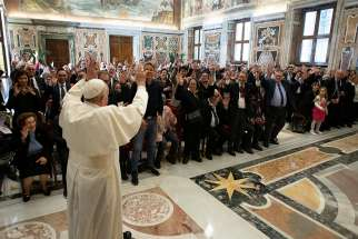 Pope Francis waves during a meeting with members of the Italian Federation of Associations for the Deaf at the Vatican April 25, 2019.