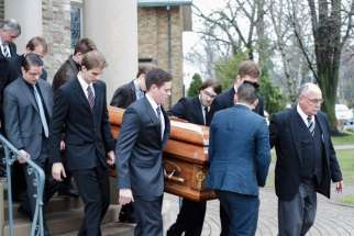 Pallbearer's carry Joanne McGarry's casket out of the Our Lady of Perpetual Help Church following her May 1 funeral.