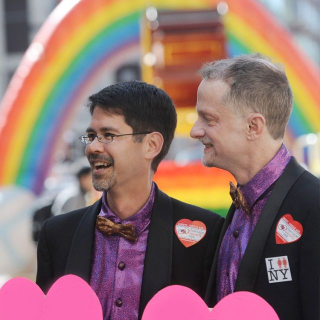"Stuart Gaffney and John Lewis, who have been together for 24 years, attend a gay pride parade in San Francisco in late June1. A letter signed by more than three dozen U.S. religious leaders objects to the specter of religious groups being forced to treat same-sex unions ""as if they were marriage."""