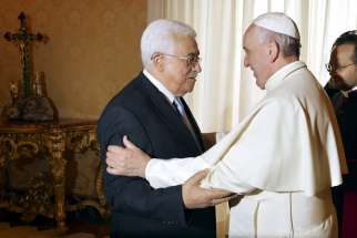 Pope Francis greets Palestinian President Mahmoud Abbas during a private audience at Vatican in 2015. Abbas is set to meet with the Pope again on Jan. 14.