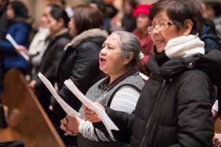 Filipinos worship during a Simbang Gabi Mass at Holy Rosary Cathedral in Vancouver, British Columbia, Dec. 15.