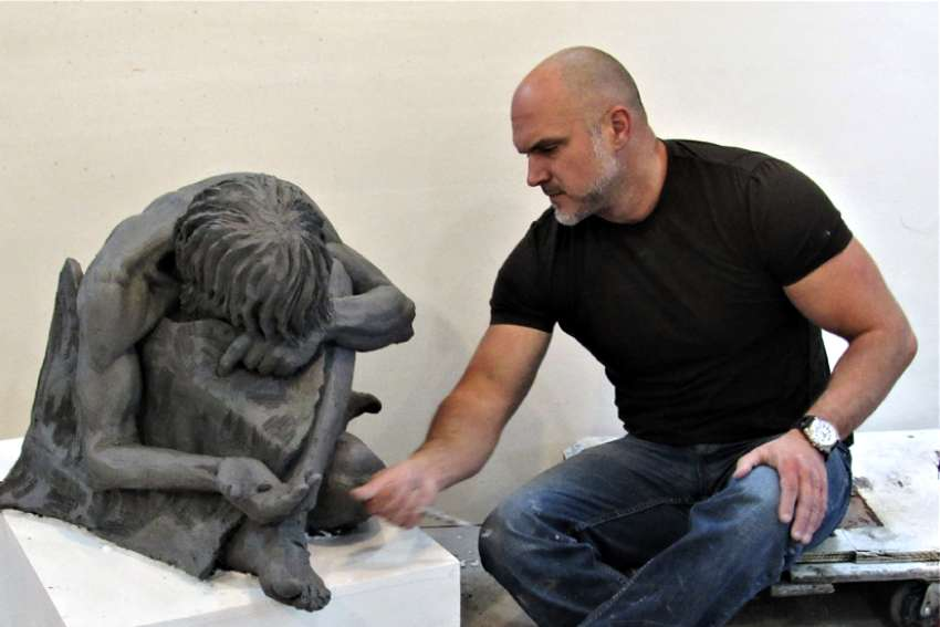 Timothy Schmalz works on the clay model for his bronze sculpture When I Was Naked.
