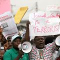 Protesters hold placards and shout slogans in Lagos, Nigeria, Jan. 3. Hundreds of demonstrators closed gas stations, formed human barriers along motorways and hijacked buses in protest against the doubling of fuel prices after a government subsidy was re moved.