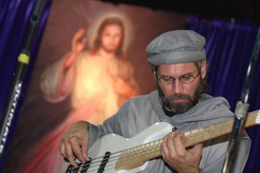Fr. Stan Fortuna has toured the world, making music and raising funds for the poor.