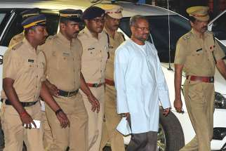Bishop Franco Mulakkal of Jalandhar, India, is led away for questioning by police Sept. 21 on the outskirts of Cochin. A state court in southern India has denied bail to Bishop Mulakkal who is accused of raping a nun on grounds that he could influence witnesses if released from jail.