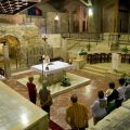 Mass is said at the altar by the grotto inside the Church of the Annunciation in Nazareth. The site is believed to be the childhood home of Mary. Below, the altar inside the Grotto of the Annunciation, believed to be the childhood home of Mary, which is located on the lower level of the Church of the Annunciation.