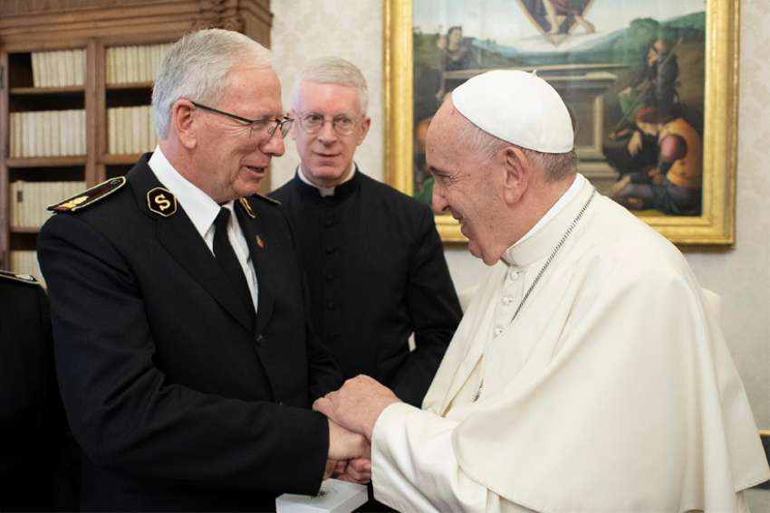 Pope Francis greets Gen. Brian Peddle, international representative and CEO of the Salvation Army, at the Vatican Nov. 8, 2019.