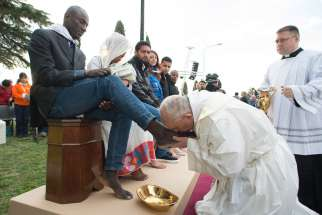 Pope Francis kisses the foot of a refugee during Holy Thursday Mass of the Lord's Supper at the Center for Asylum Seekers in Castelnuovo di Porto, about 15 miles north of Rome March 24. The Pope washed and kissed the feet of refugees, including Muslims, Hindus and Copts.