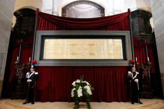 Carabinieri police officers stand guard in front of the shroud in Turin, Italy, May 2, 2012.