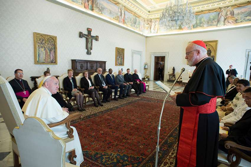 Pope Francis listens as Cardinal Sean P. O'Malley of Boston, president of the Pontifical Commission for the Protection of Minors, speaks during a meeting with members of the commission at the Vatican April 21.