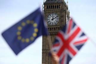 A European Union flag and British Union flag are seen at Parliament Square in London June 19. Voters in the United Kingdom voted June 23 to leave the European Union.
