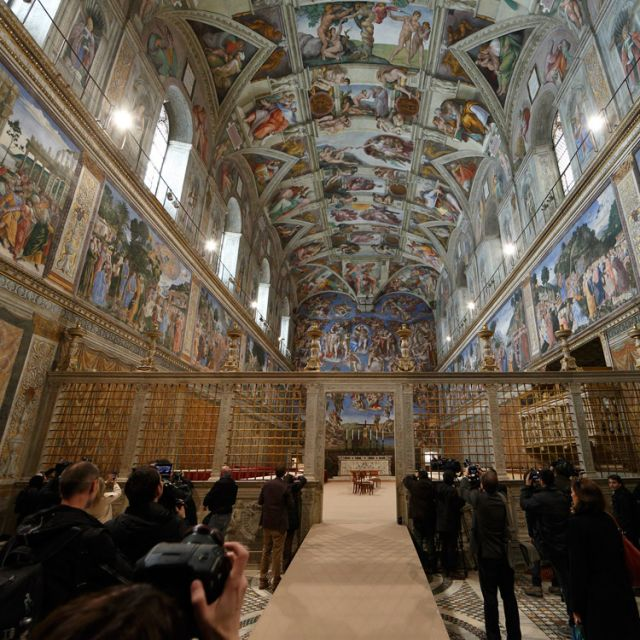 Members of the media preview the Sistine Chapel as preparations continue for the conclave March 9 at the Vatican. Cardinal electors will enter the chapel in the afternoon March 12 to begin the conclave to elect the new pope.