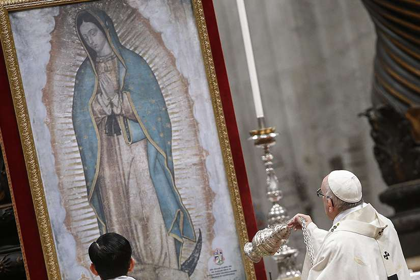 Pope Francis swings a censer in front of an image of Our Lady of Guadalupe as he celebrates Mass Dec. 12 marking her feast day in St. Peter's Basilica at the Vatican.
