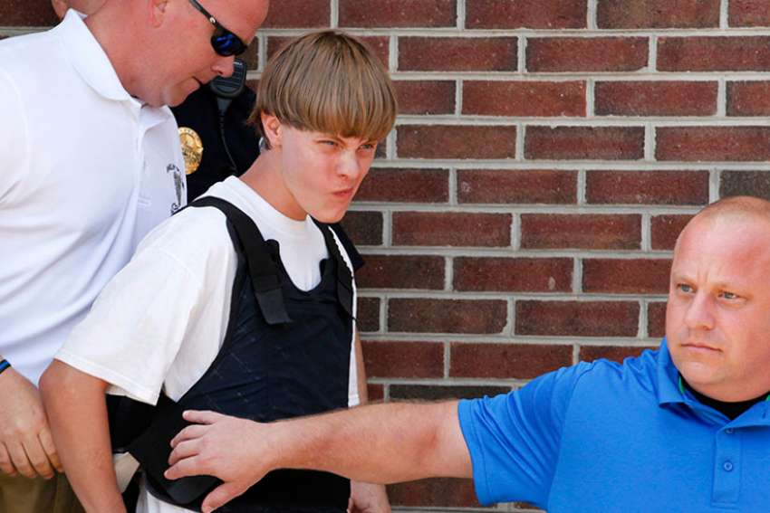 Police lead suspected shooter Dylann Roof, 21, into the courthouse in Shelby, N.C., on June 18, 2015.
