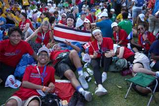 Canadian pilgrims wait patiently for the Pope's arrival at Pope John Paul II field in Panama City Jan. 22.