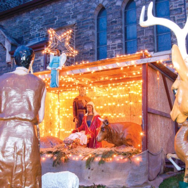 The life-sized Nativity scene outside St. Francis of Assisi parish is a tradition that dates back to the early 1970s.