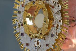 A Catholic Sorb holds the monstrance during the annual Corpus Christi procession May 31 in Crostwitz, Germany.