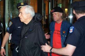 Daniel Berrigan arrested for civil disobedience outside the U.S. Mission to the U.N. in 2006.