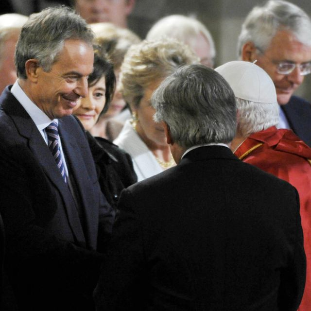 Pope Benedict XVI greets former British Prime Minister Tony Blair in Westminster Hall in London in 2010. Blair, previously an Anglican, was received into full communion with the Catholic Church in 2007.