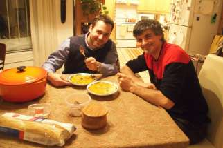 Ryan Worms and Luke Stocking are enjoying a piece of bread and a bowl of soup together.