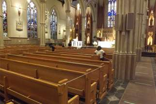 Pews were roped off and tape placed on the floor to ensure physical distancing as the first public Mass in three months was held at St. Michael's Cathedral in Toronto on June 17.